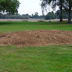 A pile of woodchip, the remains of a tree stump after stump grinding is completed